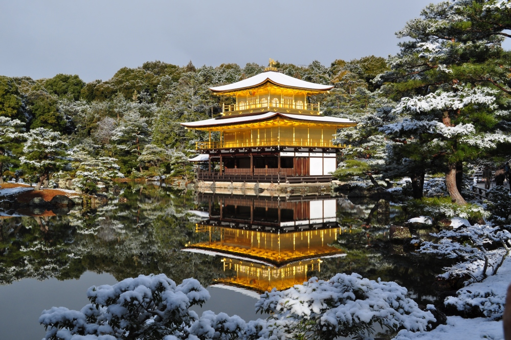 Mirror of Gold and Snow at the Golden Pavilion in Kyoto, Japan by Eric Walker