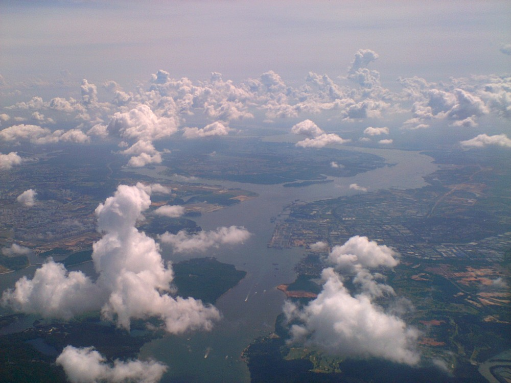 Aerial view of Singapore and Malaysia on the border by Maria Bravo