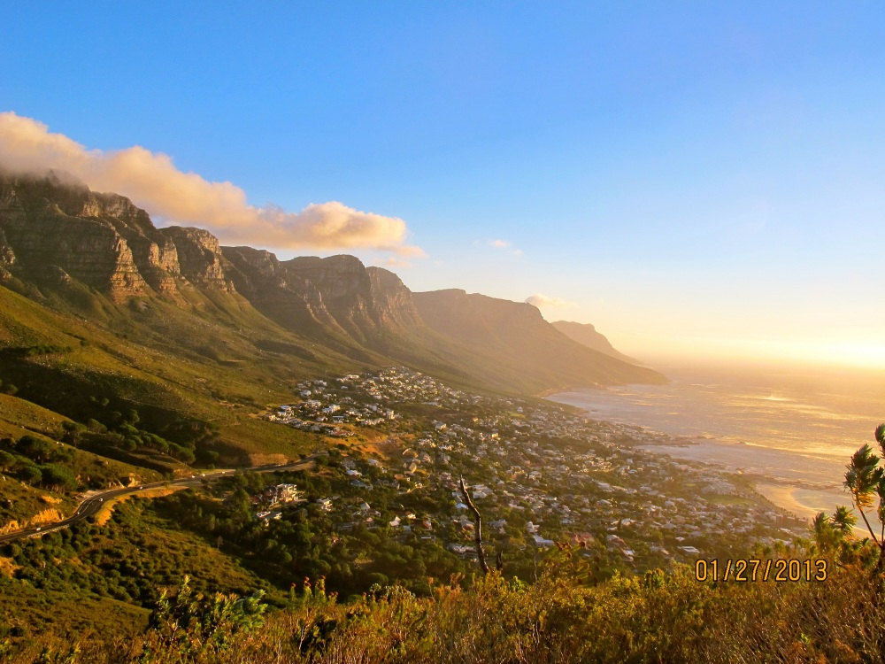 A view from the Lion's Head looking at the Table Mountain's mountain range facing the Atlantic Ocean known as the Twelve Apostles in Cape Town, South Africa by Jeremy Goldman