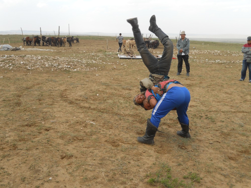Mongolian Wrestling in the grasslands of Inner Mongolia in Hohhot, China by Jason Schut
