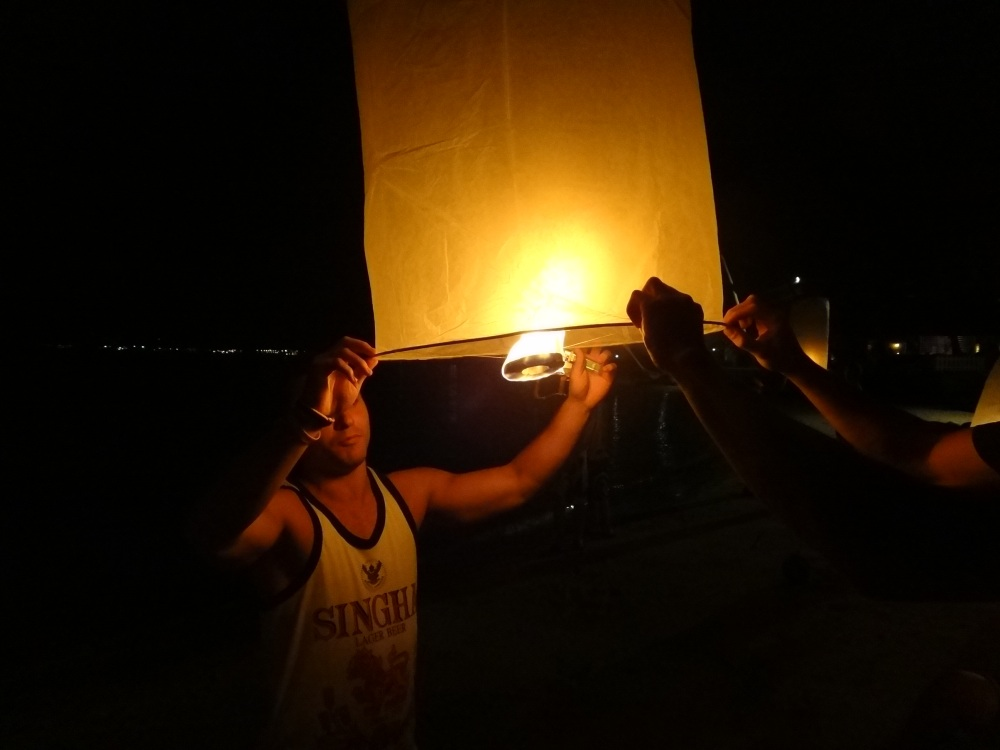 Launching a hot air lantern in Phuket, Thailand by Sterling Lirot
