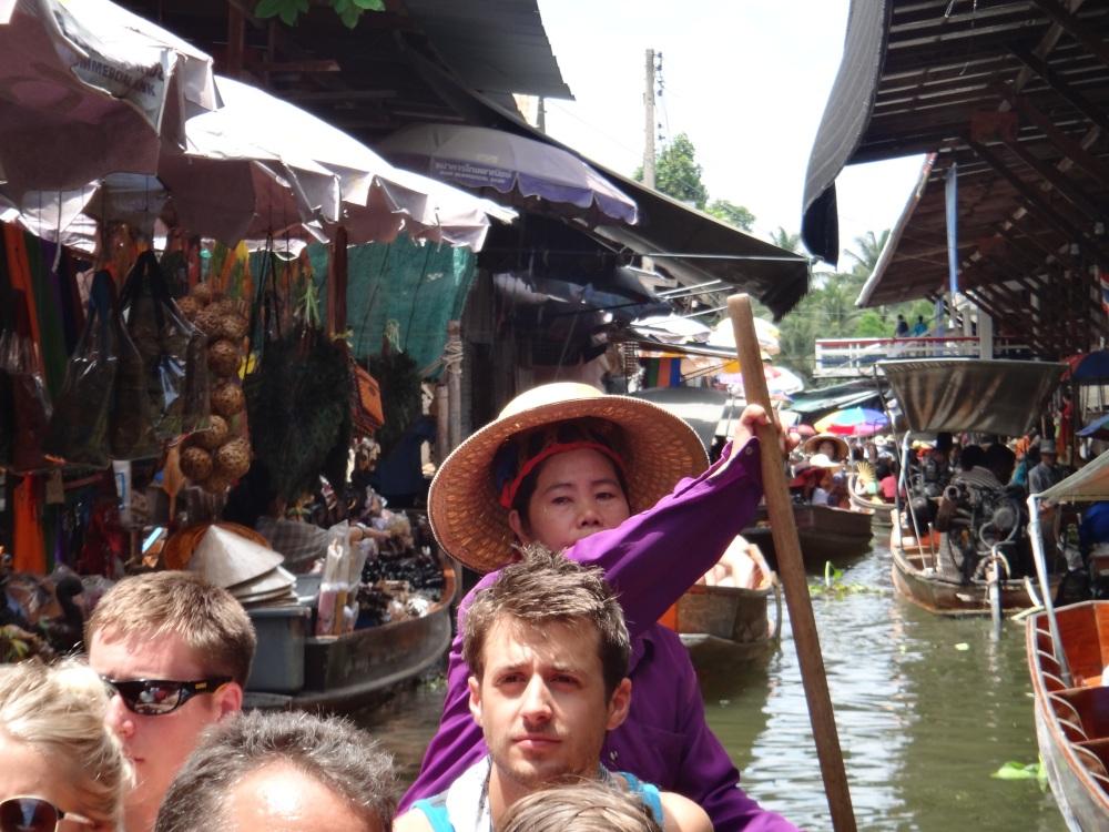 Floating Market in Rachaburi, Thailand by Daniel Lizzio