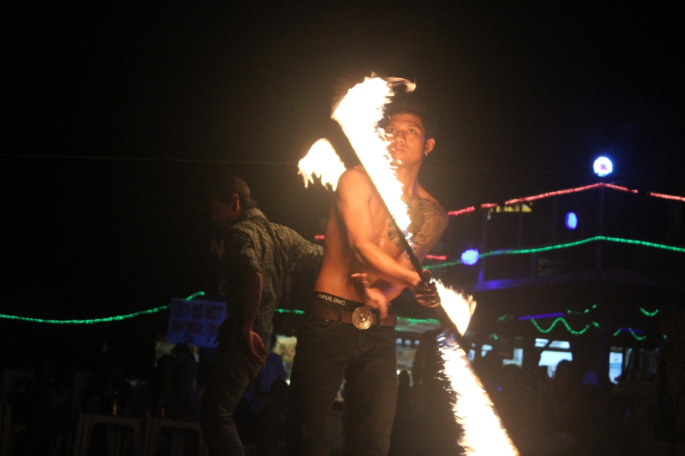 The fire performer at the Slinky Bar on Phi Phi Island in Thailand by Troy Masco