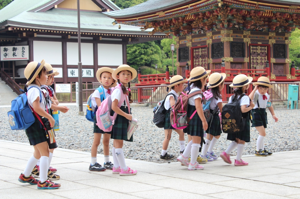 Local japanese children with a school trip at Naritasan Temple in Narita, Japan by Chase Olender