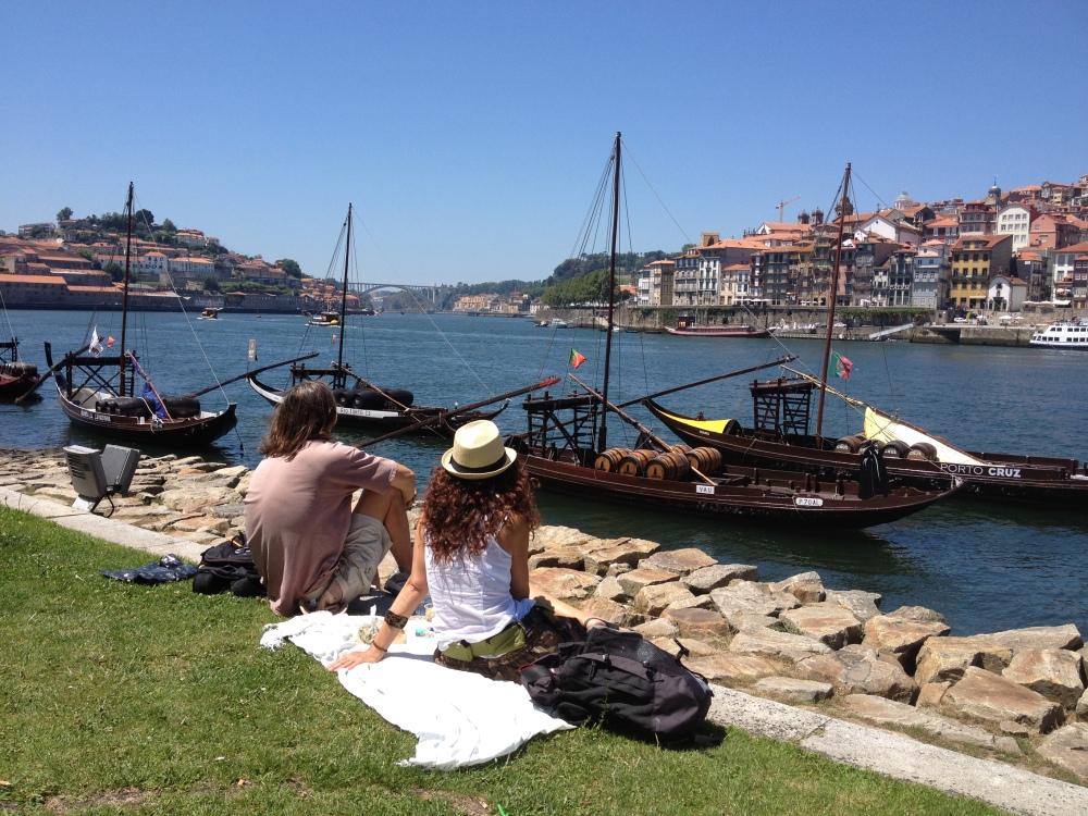 A couple enjoying the Douro River in Porto, Portugal by Bridget Valenti