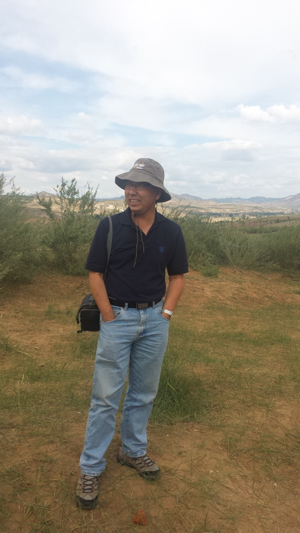 Dr. Liu, faculty director, at the Grasslands