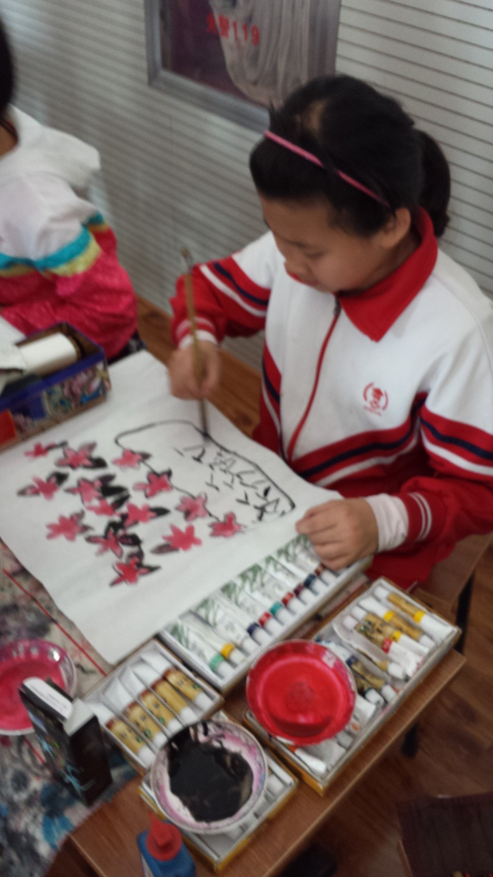Elementary children hand painting pictures